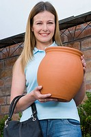 Customer holding a decorative urn