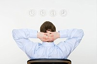 Businessman and wall clocks