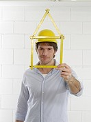 Man with a folding rule looking like a house (thumbnail)