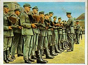 German re_armament and militarisation: German infantrymen lined up for boot inspection. From series of 270 cigarette cards 'Die Deutsche Wehrmacht', D...