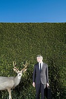 Businessman looking at deer