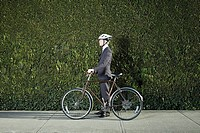 Businessman with bicycle and helmet