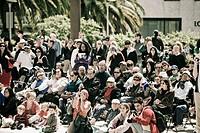 Spectators taking a picture, Union Square, San Francisco, California, USA