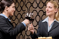 Businesswomen toasting with wine