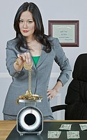 Businesswoman weighing gold jewelry