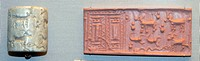Assyrian cylinder seal from a grave. It depicts two pillars, a goat, a scorpion and serpent. A cylinder seal is a cylinder engraved with a 'picture st...
