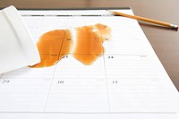 Coffee spilt on a calendar