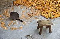 Detail of a stool and corn on the floor in Long Ji, China