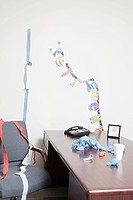 Streamers and decorations celebrating retirement strewn over office desk