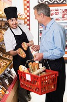 Salesman talking to a customer in a supermarket