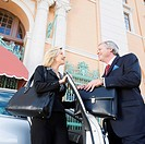 Two business executives looking at each other and smiling, Biltmore Hotel, Coral Gables, Florida, USA