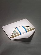 Hundred dollar bills in envelope