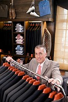 Portrait of a businessman in a clothing store