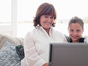 Girl and grandmother with laptop