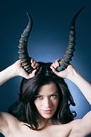 Young woman with horns