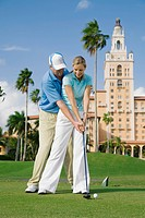 Golf instructor teaching golf to a woman, Biltmore Golf Course, Biltmore Hotel, Coral Gables, Florida, USA