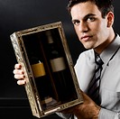 Businessman showing a pair of wine bottles
