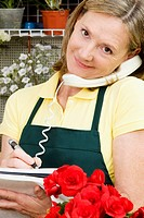 Female florist talking on the phone