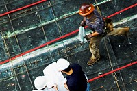 High angle view of two architects standing with a construction worker at a construction site