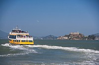 Ferry in the sea with a prison in the background, Alcatraz Prison, Alcatraz Island, San Francisco Bay, San Francisco, California, USA