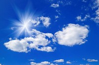 Sunbeams and clouds in a blue sky