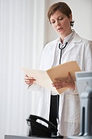 Female doctor reviewing notes