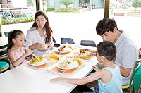Young family with two children dining in the restaurant together, Family, Leisure Activities