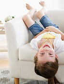 Child playing on sofa