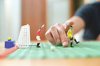 Man playing with a Table Soccer Game Detail (thumbnail)