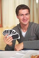 Man holding Playing Cards