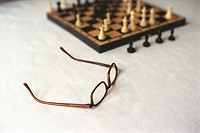 Chess Board and Glasses standing on Table