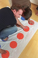 Men playing Twister