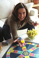 Woman playing Trivial Pursuit