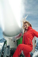 Young woman posing beside a snowmaking gun