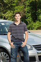 Young man with his car