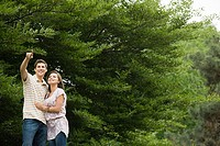 Young couple near trees