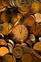 pocket watch on world stock coins