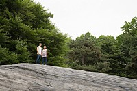 Young couple standing on a rock