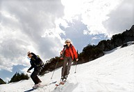 senior couple skiing in mountains