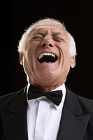 Laughing man in a dinner jacket