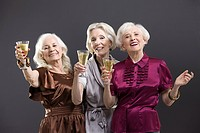 Senior female friends toasting with champagne (thumbnail)