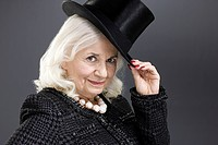 Senior woman with top hat