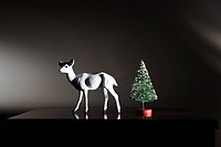Miniature reindeer and christmas tree
