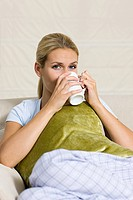 Ill woman with hot drink