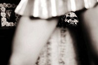 Woman´s legs in miniskirt with skull