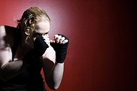 Woman in boxing stance (thumbnail)