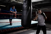 Boxer and coach in gym (thumbnail)