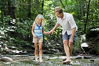 Father and daughter in river (thumbnail)