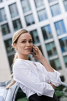 Young businesswoman using a cellular telephone