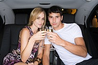 Couple celebrating in the back of a car